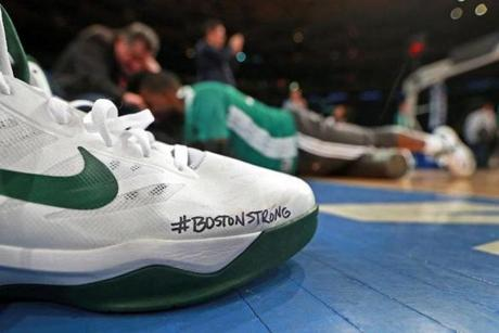 "The ""Boston Strong"" logo appeared on a pair of sneakers at a Celtics workout on Monday."